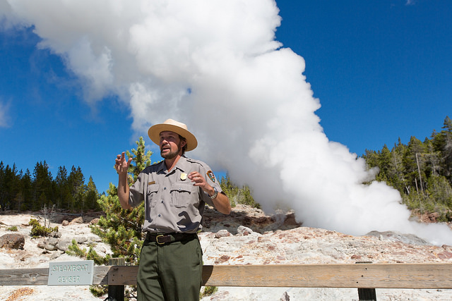 ParkRangertalkinginfrontofSteamboatGeyser in Yellowstone National Park