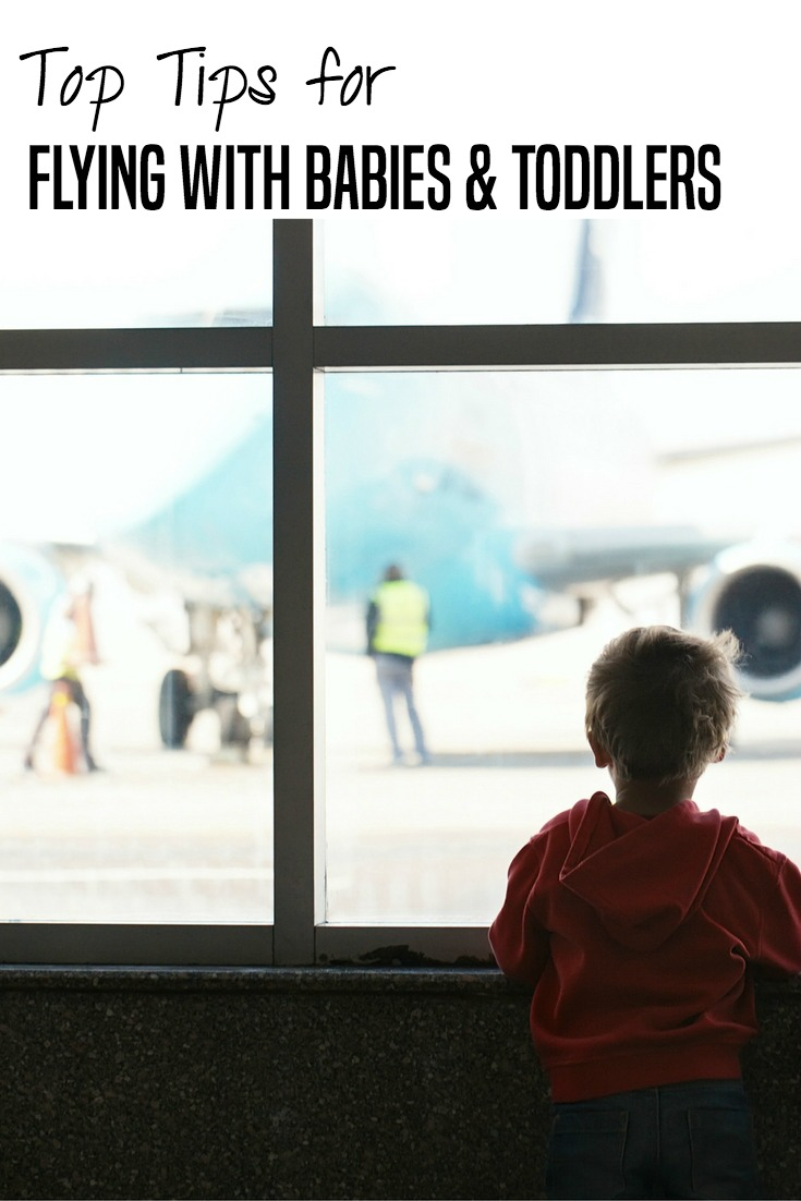 Tips for flying with babies and toddlers from full-time travelers and family travel podcasters.