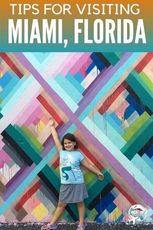 Tips for visiting Miami FL with kids girl in front of wynwood wall mural