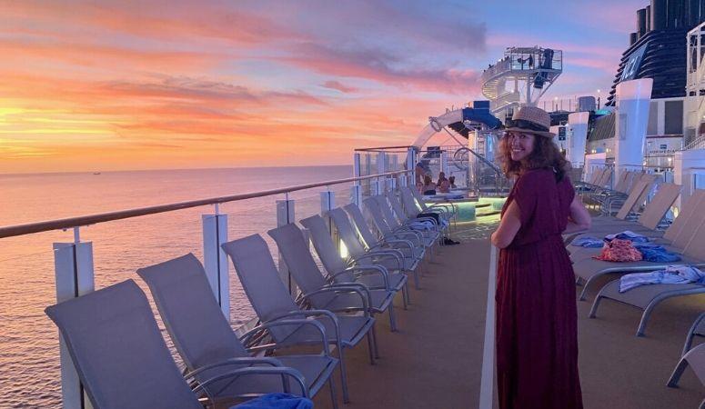 Dana Freeman on a cruise ship at sunset