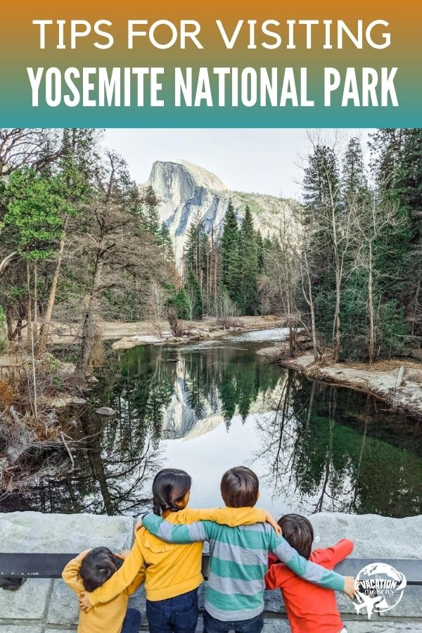 Tips for Visiting Yosemite National Park family with arms around each other overlooking water with mountains in the background