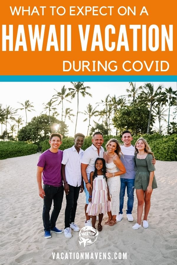 What to expect on a Hawaii vacation during COVID with family on the beach in front of palm trees