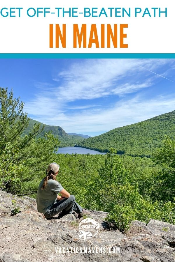 Off-the-beaten path in Maine pinterest image with woman sitting on mountain overlooking a pond and trees