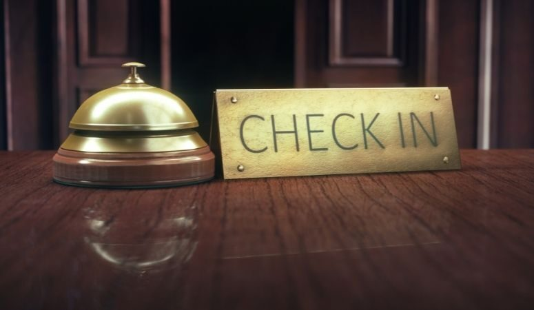 Check in sign and bell